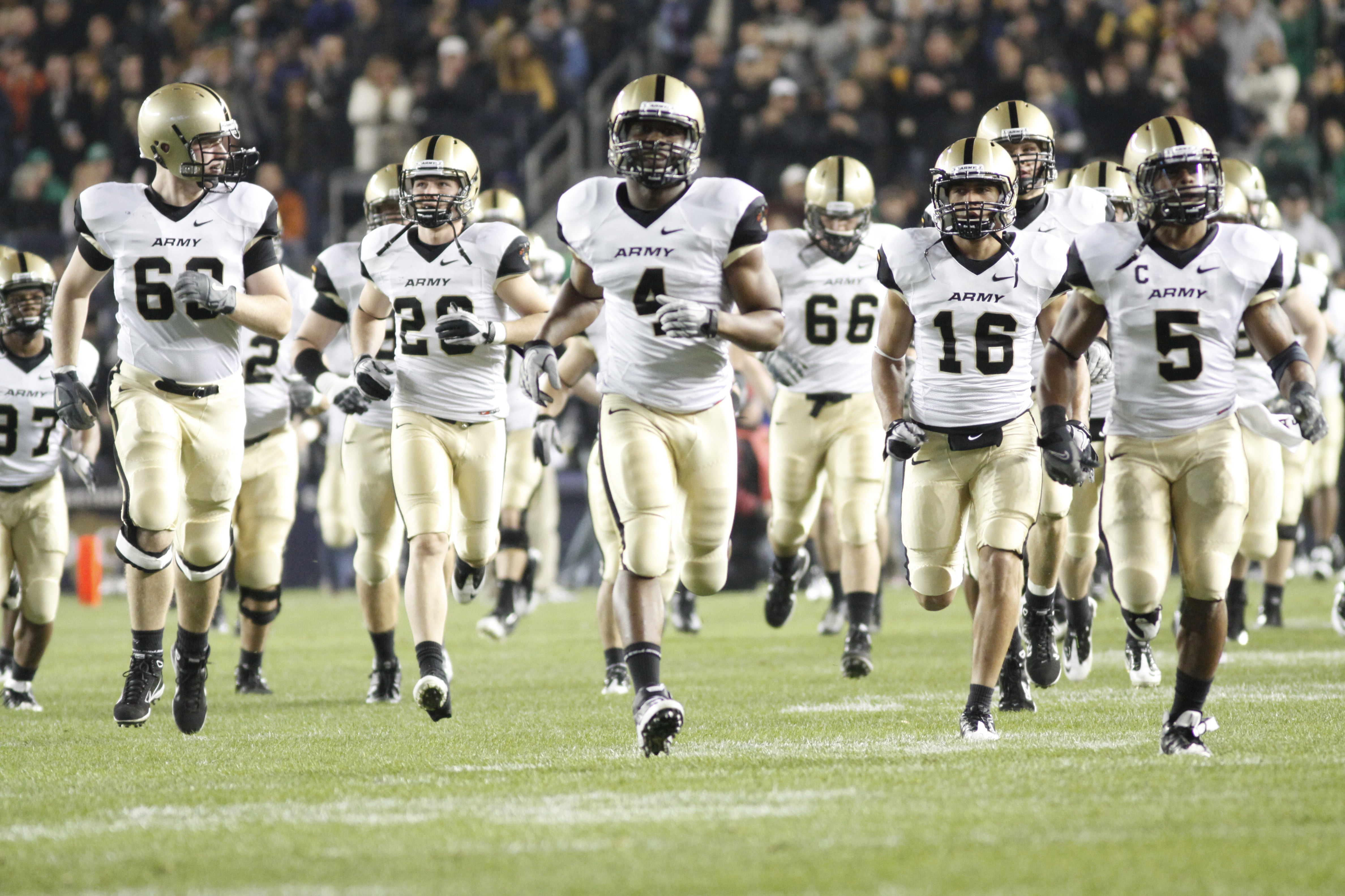 The Black Knights storm onto the field at the start of the Army-Notre Dame game Nov. 20 at Yankee Stadium. The game's attendance was 54,251. Photo by Mike Strasser, West Point Public Affairs